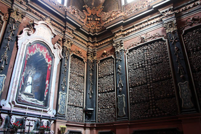 San Bernardino alle Ossa is an ossuary decorated with numerous human skulls and bones.