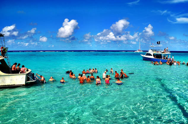 Skip the day visit and plan on a real vacation in the Caymans using these tips as your guide.