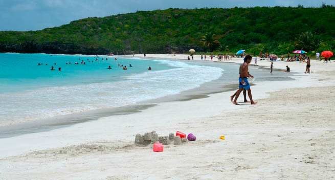 People play on a beach in Puerto Rico.