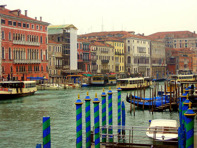Venice is a city in northeastern Italy sited on a group of 118 small islands separated by canals and linked by bridges