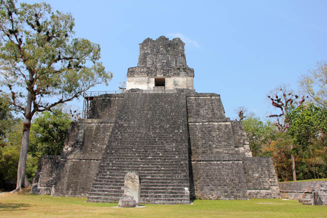 Tikal is the ruins of an ancient city found in a rainforest in Guatemala.